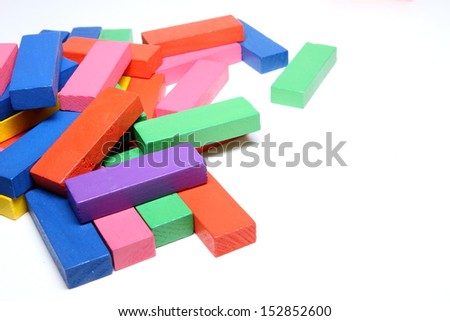 Colorful wooden blocks on white background.