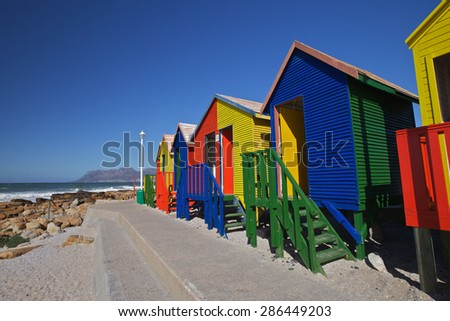 Colorful wooden changing cabins at the Beach St James Beach, Cape Town, South Africa