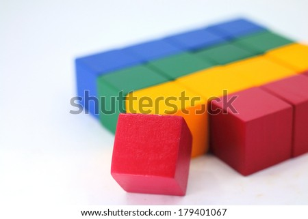 Colorful wooden childen's building blocks scattered loose