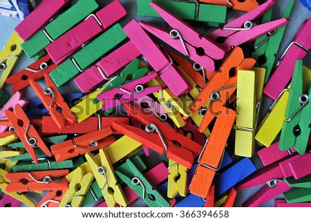 Colorful wooden clothespins  - stock photo