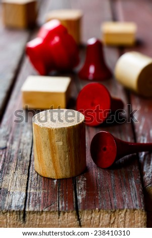 colorful wooden cubes on wooden texture, selective focus - stock photo