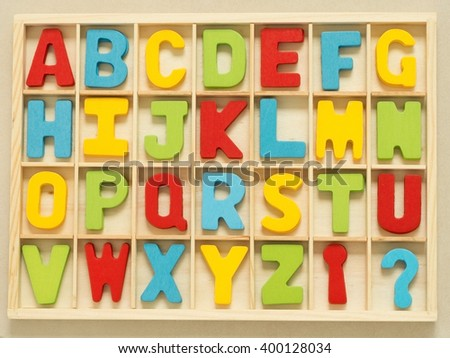Colorful wooden English alphabet set in wood box. - stock photo