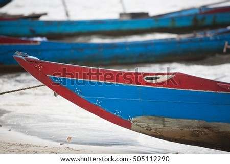 Colorful wooden fishing boats moored on the banks of a river, central Vietnam
