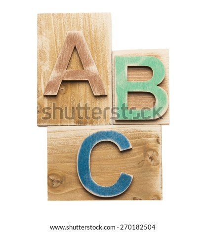 Colorful wooden letters A B C on wooden blocks isolated on white background - stock photo