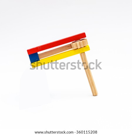 Colorful wooden noisemaker Purim holiday - stock photo