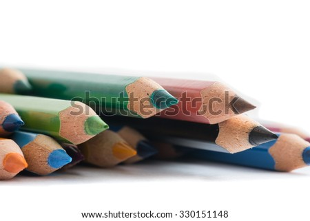 Colorful wooden pencils on white background