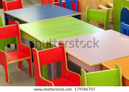 colorful wooden tables and chairs