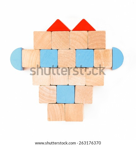 Colorful wooden toy arrangement as robot head isolated on white background - stock photo