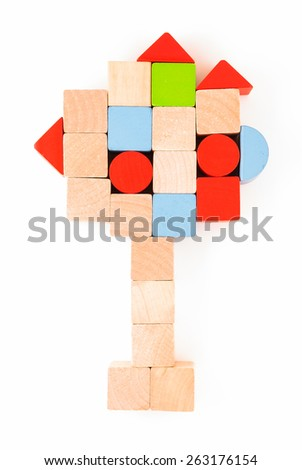 Colorful wooden toy arrangement as tree isolated on white background - stock photo
