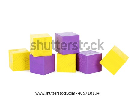 Colorful wooden toy cubes isolated on a white - stock photo