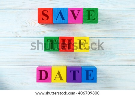 Colorful wooden toy cubes on a blue wooden background - stock photo
