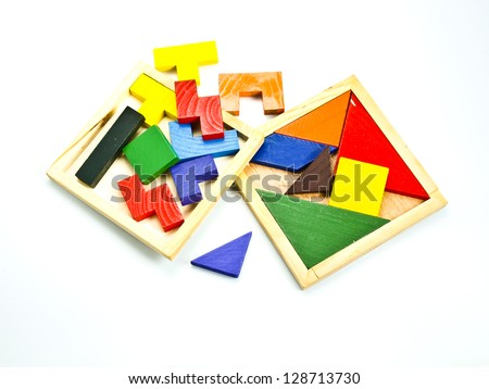 colorful wooden toy puzzle in red, yellow, green and blue, isolated on white. - stock photo