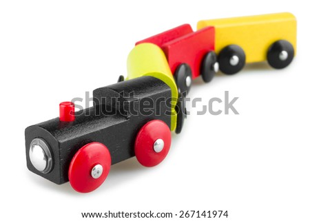 Colorful wooden toy train isolated over white background - stock photo