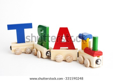 Colorful wooden toy train with ART letters isolated on white background
