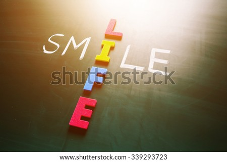 Colorful word life and writing word smile crossing on blackboard
