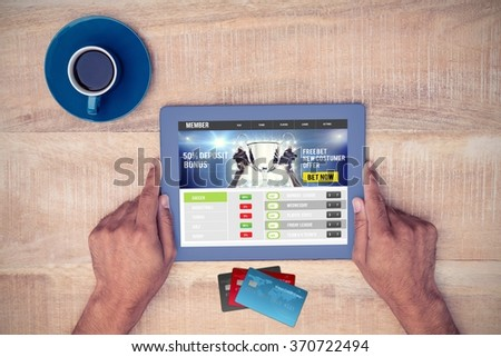 Colorful world credit cards against hand holding on digital tablet over table by coffee