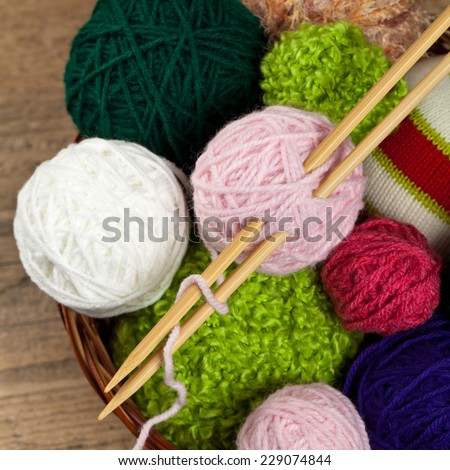 Colorful yarn balls in wicker basket. Selective focus. - stock photo