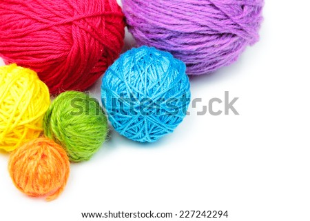 Colorful yarn balls isolated on white background - stock photo