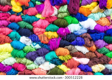 Colorful yarn for sale in the famous market in Otavalo, Ecuador - stock photo