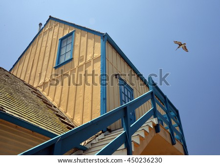 colorful yellow and blue cottage in Fisherman's Village, Marina Del Rey, California - stock photo