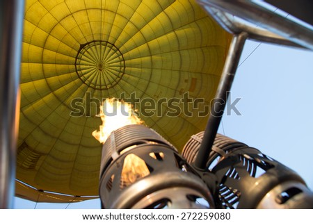 colorful yellow hot air balloon in sky of Laos - stock photo
