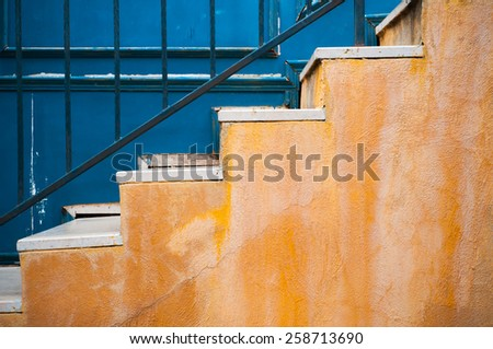 Colorful yellow stair and contrast blue wall  - stock photo