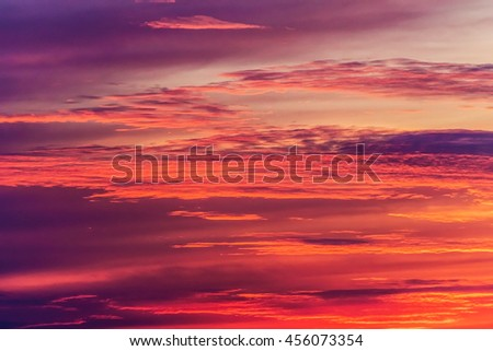 colorful yellow sunrise, sunset clouds and sun rays