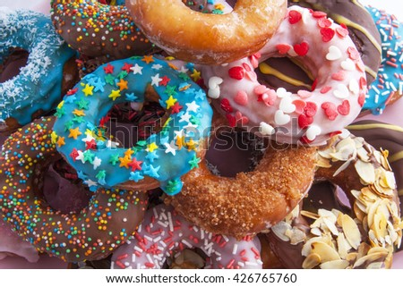 Colorfull delicious donuts for background use - stock photo