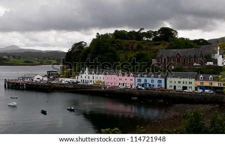 Colorfull houses in Portree harbour, Isle of Skye, Scottish highlands. - stock photo