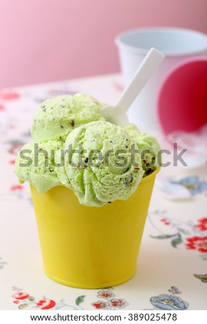 colorfull icecream in yellow metal cup kitchen table background