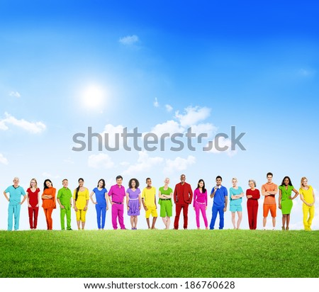 Colorfully Dressed Multi-Ethnic People in a Row Outdoors
