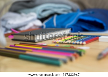 Colorfully Office and art stationery objects on wood table with a notebook.In selective focus