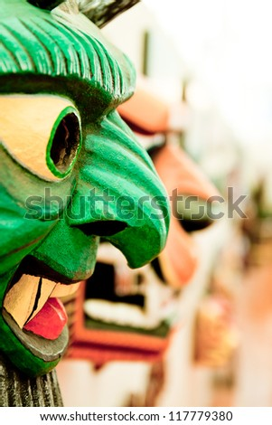 Colorfully painted wooden South American mask - stock photo