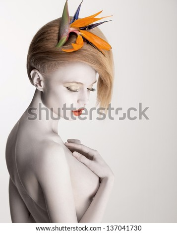 Coloring. Bodypainting. Beautiful Dreamy Woman with Flower. Futurism. Silver Skin - stock photo