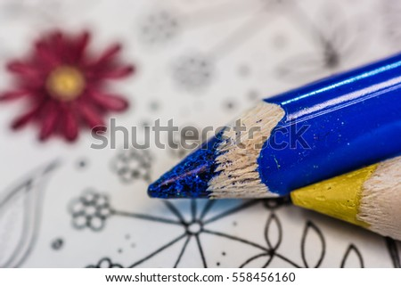 coloring book with red and yellow crayons