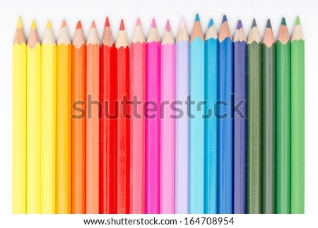 Coloring Crayons Arranged In Rainbow Line - stock photo