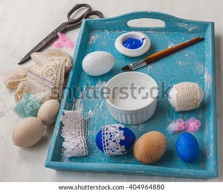 Coloring eggs and decoration lace. Easter art and handicrafts - stock photo