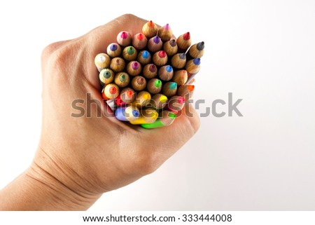 coloring pencils bunch in a hand shot on a white background top view - stock photo