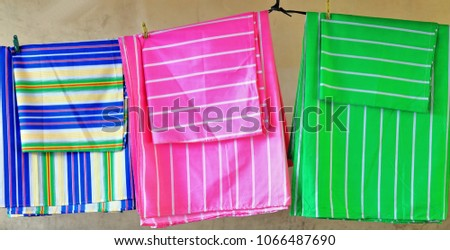Colorist Fabric Bed Sheets And Pillowcases Fixed By Plastic Clothes Pegs  Hanging From A Clothes Line