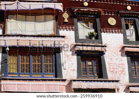 Colorist wooden windows on the white washed walls of the Drepung-Rice Heap buddhist monastery of the Gelugpa-Yellow Hat School at the foot of mount Ghephel. Lhasa pref.-Tibet A.R.-China.