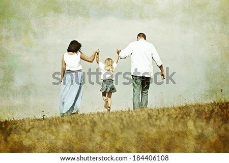 Colorized image of young family on green summer grass meadow having fun - stock photo