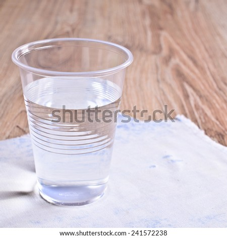 Colorless liquid in a disposable plastic Cup - stock photo
