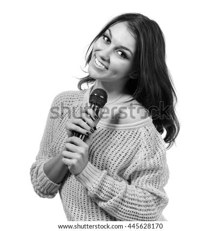 colorless portrait of beautiful young woman singer with microphone