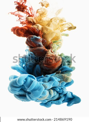 Colors dropped into liquid and photographed while in motion. Ink swirling in water. Cloud of silky ink in water isolated on white background. Colorful ink in water, an abstract banner.  - stock photo