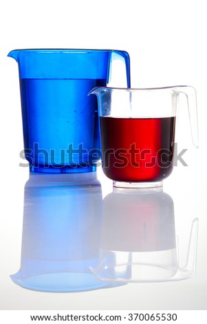 Colors jug on white background - stock photo