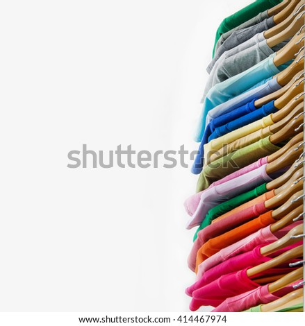 Colors of rainbow. Variety of casual female clothes on wooden hangers