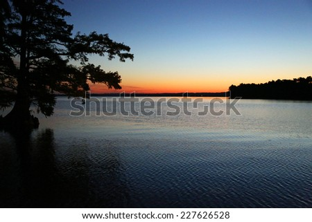 Colors of sunrise - Reelfoot Lake State Park, Tennessee - stock photo