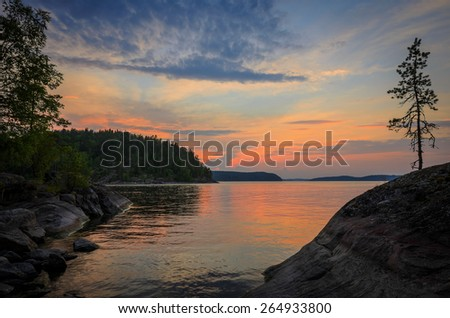 colors of sunset over the stones of north lake - stock photo