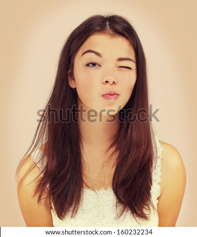 Colors.Portrait of  winking girl - stock photo