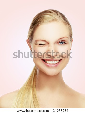 Colors.Winking Young Woman - stock photo